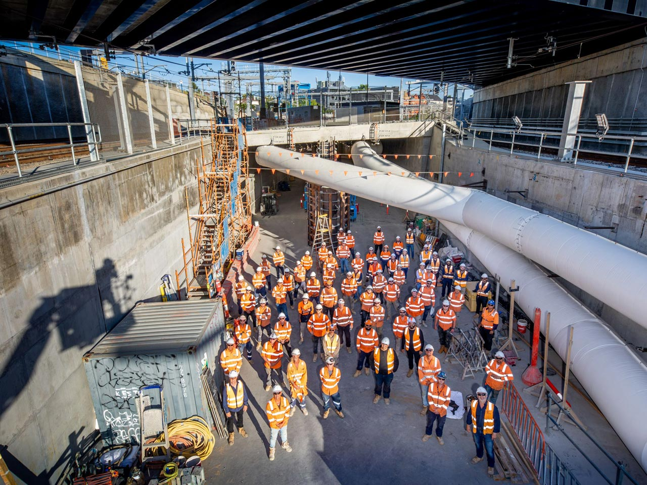 Construction staff stand at the completed eastern entrance of the Metro Tunnel
