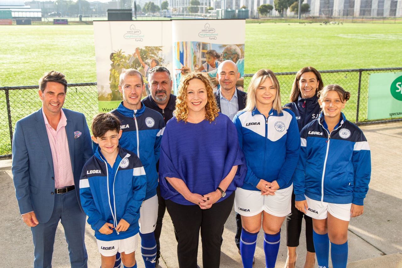 MP for Williamstown Ms Melissa Horne with members of the Yarraville Football Club - one of the recipients of the West Gate Neighbourhood Fund Parnerships stream.
