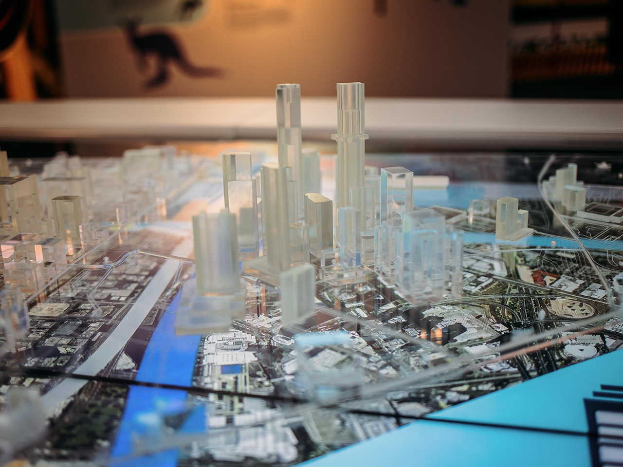 A close up of the 3D city model showing the video screen beneath it with a map of the city