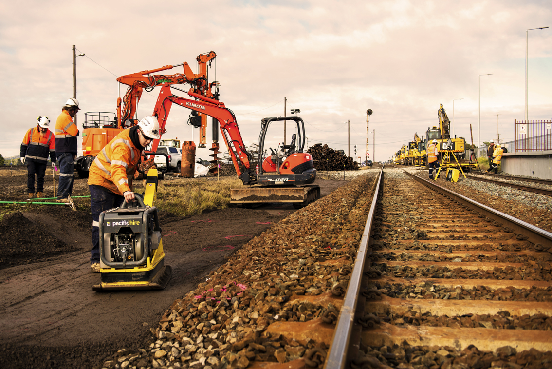 Construction workers using small and large equipment to carry out platform extension works