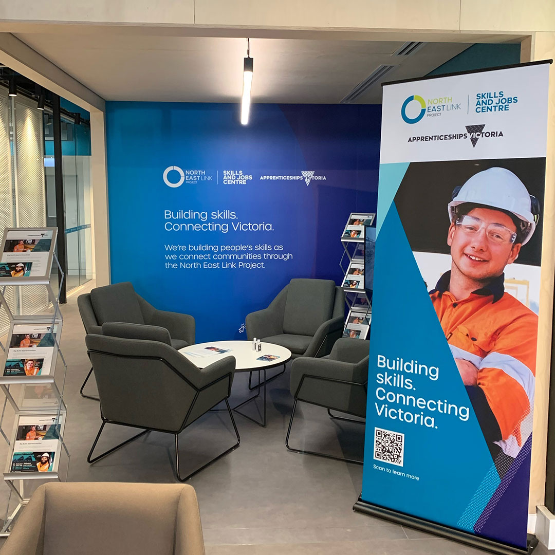 Image inside Skills and Jobs Centre including a banner, three chairs and a table