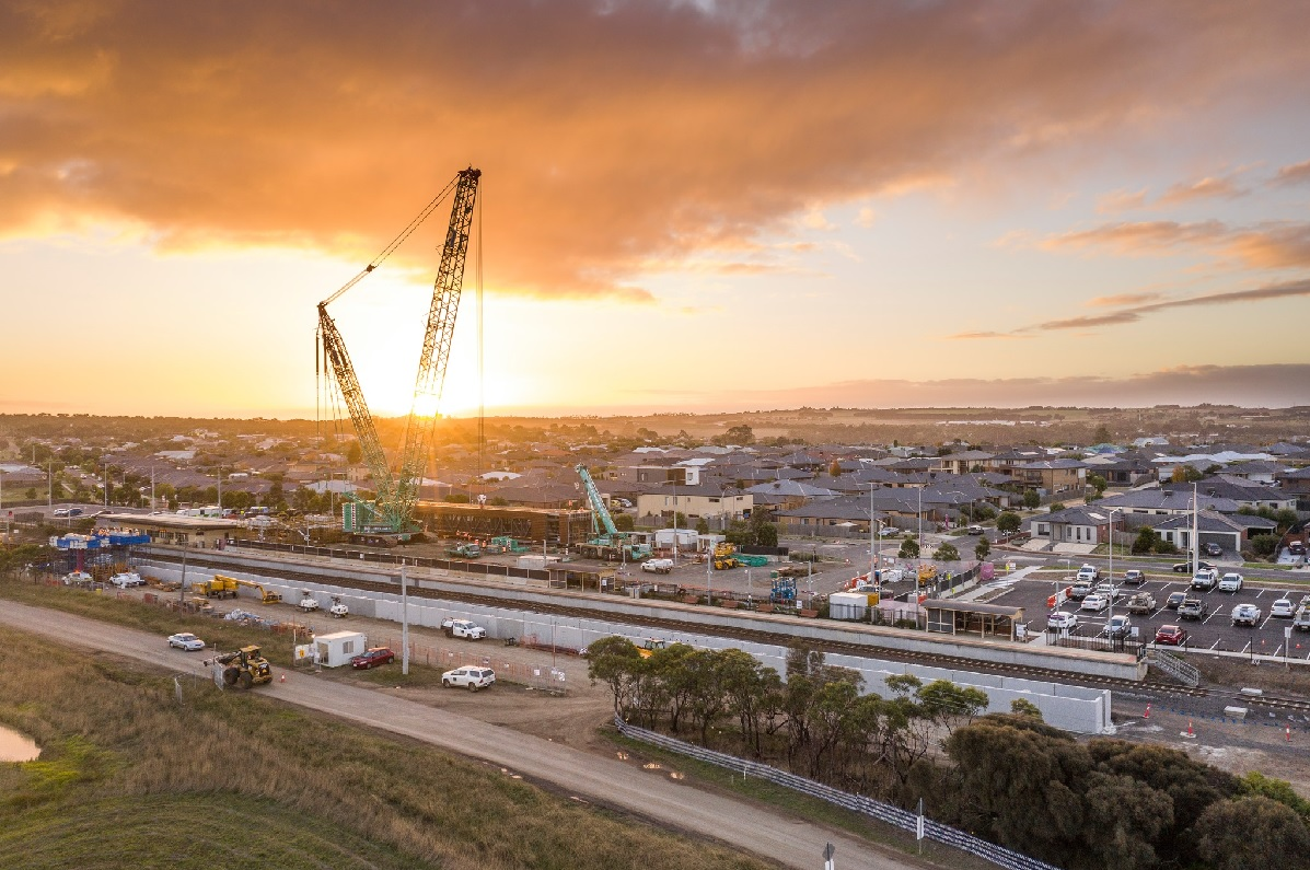 Crane lifting pedestrian overpass into place at Waurn Ponds Station