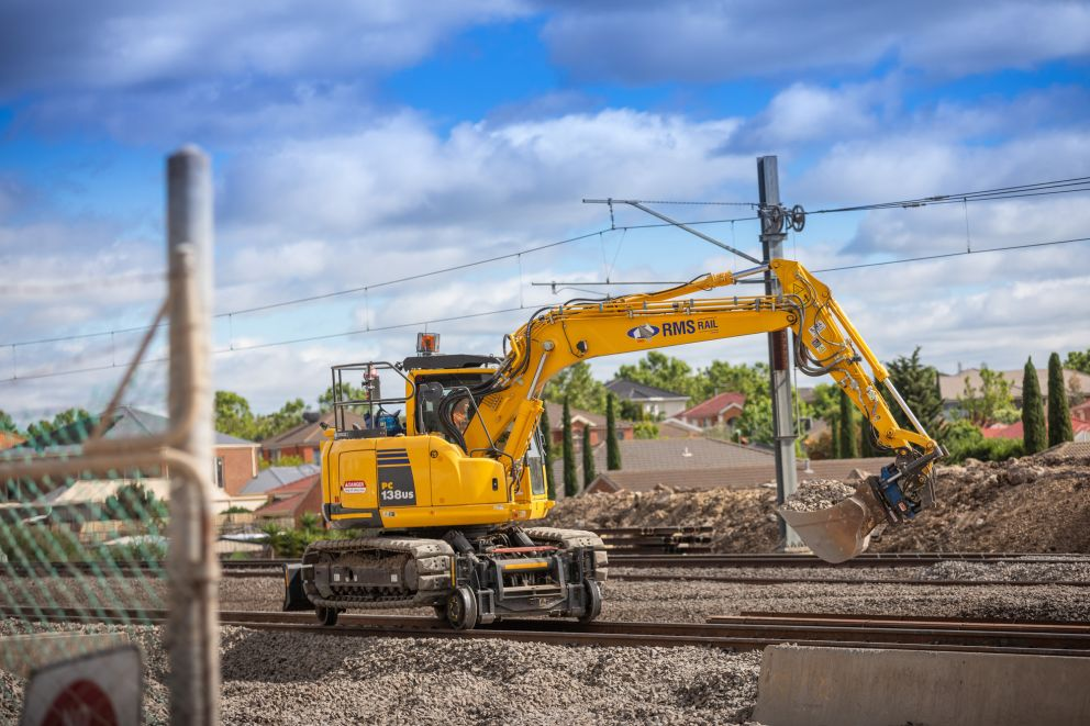 Construction equipment doing works on the rail line