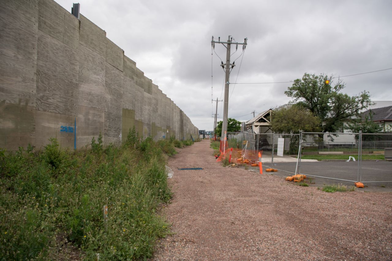 Existing noise walls lining the West Gate Freeway.